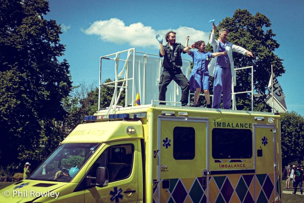 People standing on top of an ambulance